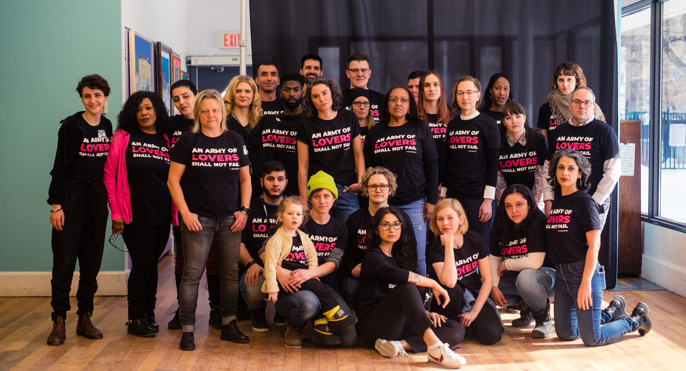 Group photo of The 519 staff wearing Army of Lovers tshirts