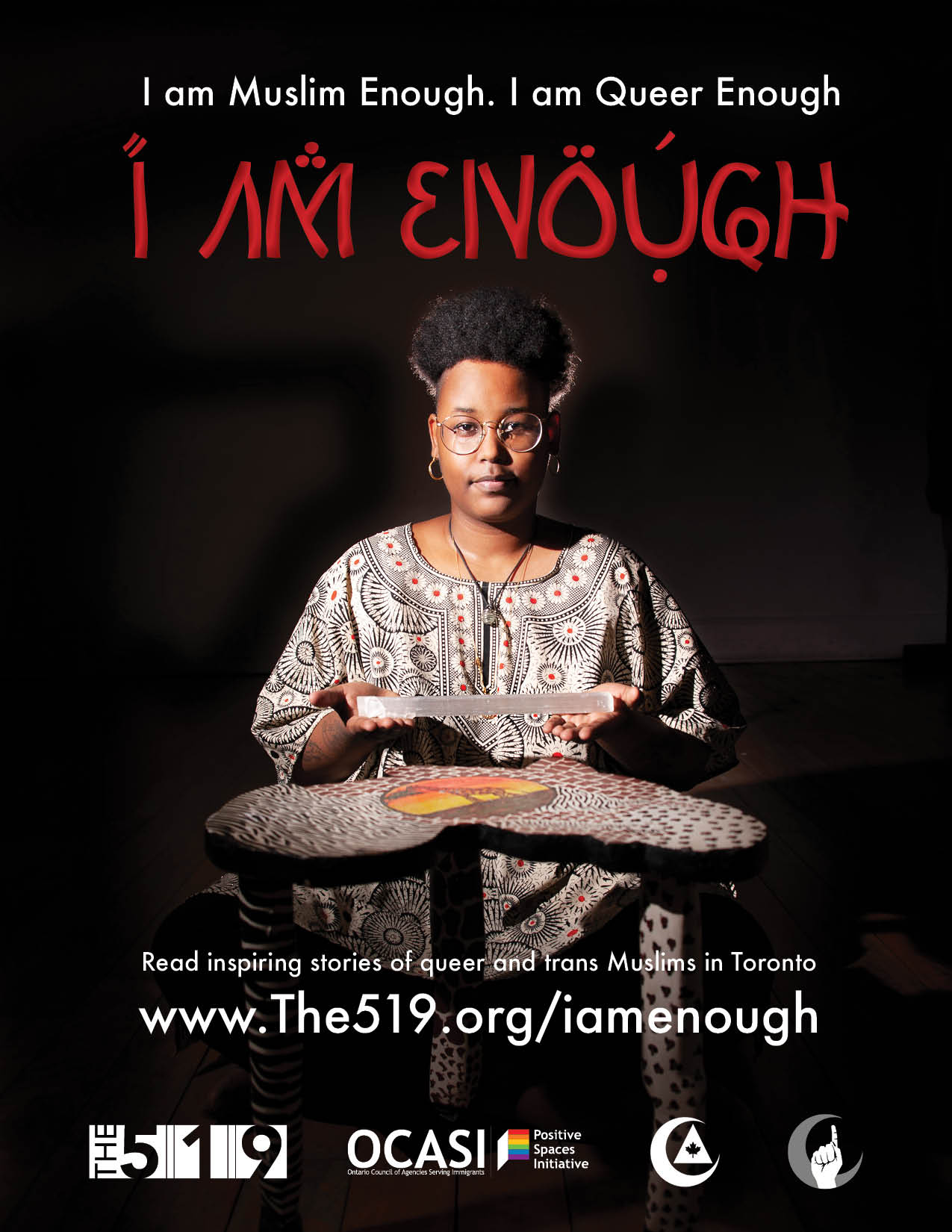 Poster: I am queer enough, I am muslim enough, I am enough. Portrait of a muslim person in front of a table with african motifs, holding a crystal.